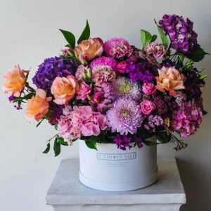 spring blooms hat box arrangement