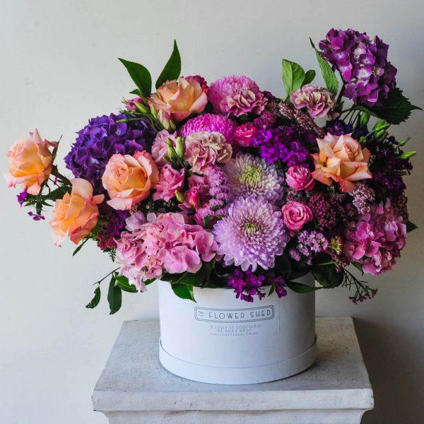 spring blooms hat box arrangement